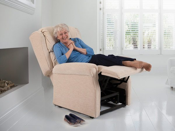 lady laying on a beige reclining chair