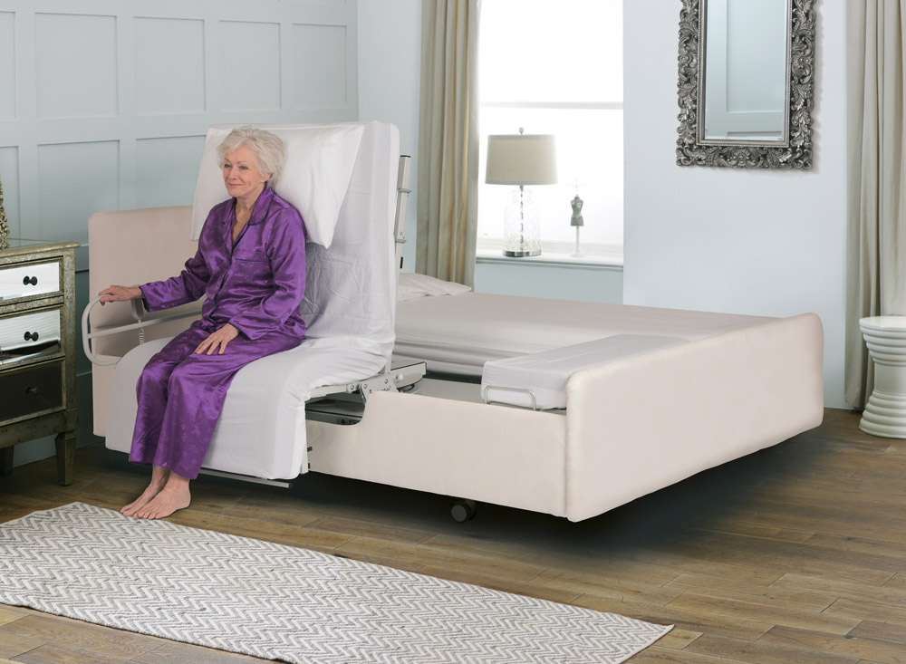 Woman sat on an adjustable rotoflex bed