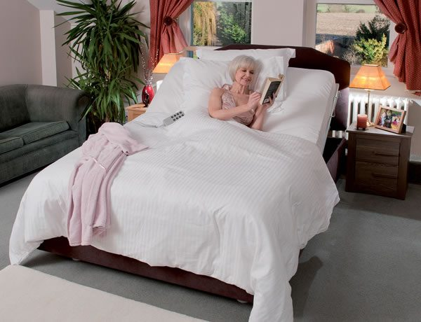 woman in white adjustable bed