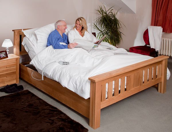 couple laughing in adjustable bed