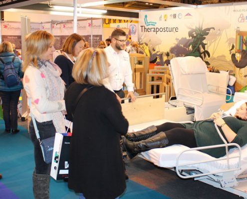 demonstrating adjustable beds at the OT Show