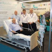 demonstrating the adjustable bed