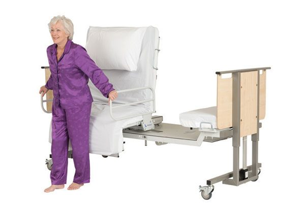 Woman standing up from adjustable bed