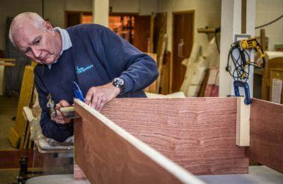 craftsman building wooden frame
