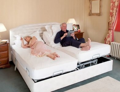 man and woman in white upholstered adjustable double bed