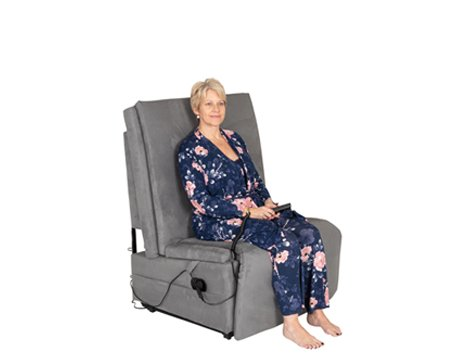 woman sitting in grey adjustable recliner chair