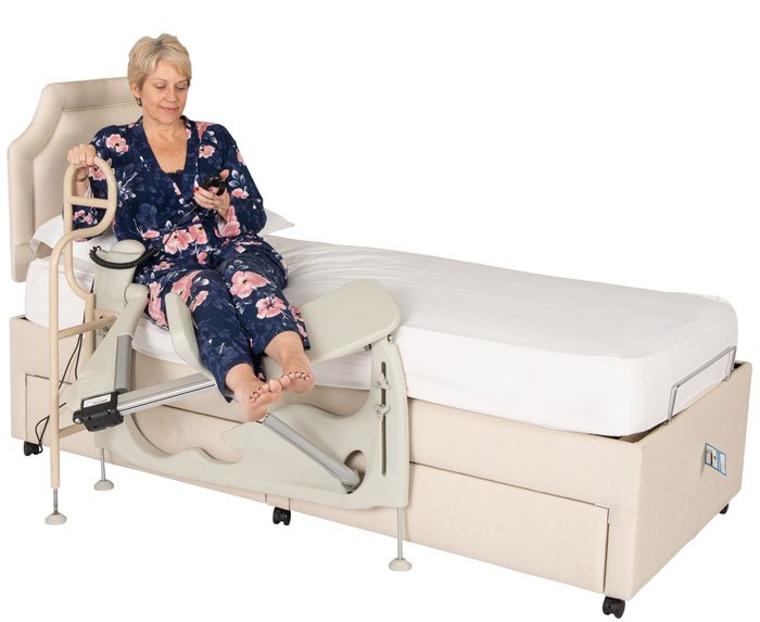 woman using leg lifter in bed