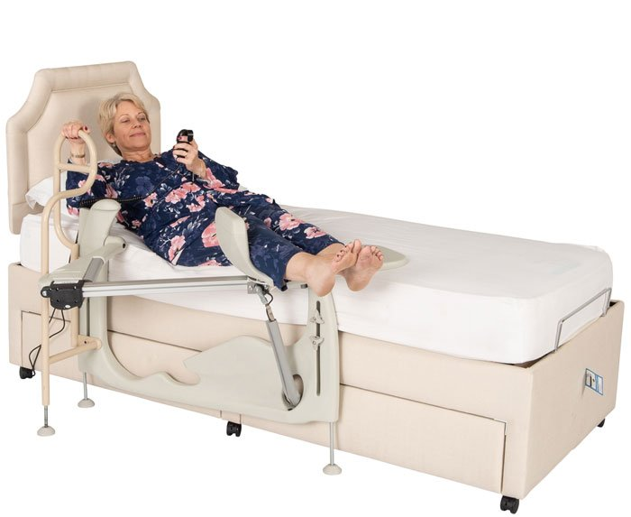 woman lifting legs into bed with machine