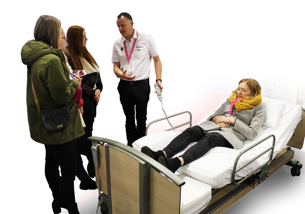 Shaun Masters OT leading educational class on adjustable beds