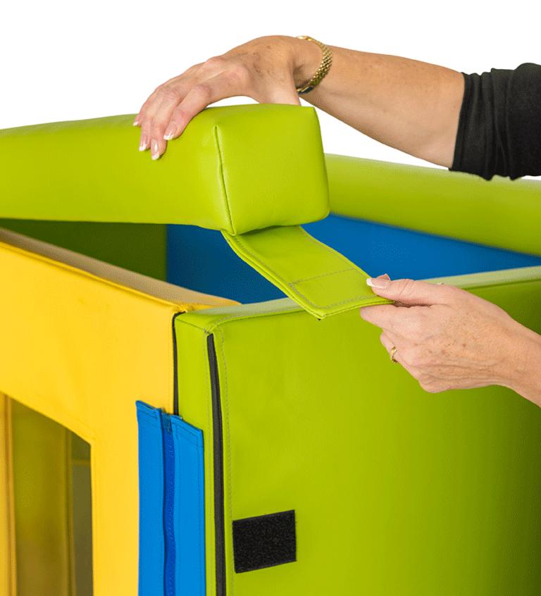 Travel cot door safety latch